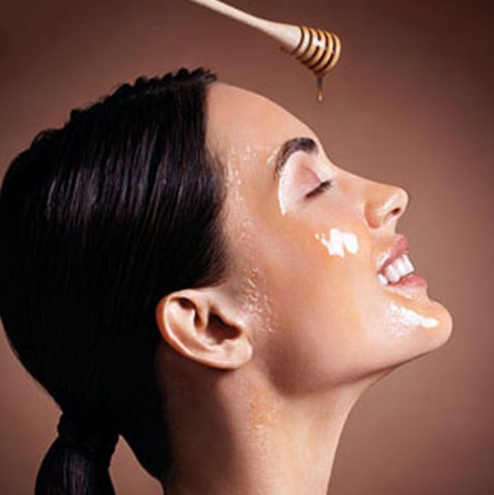 Woman pouring Honey on Face