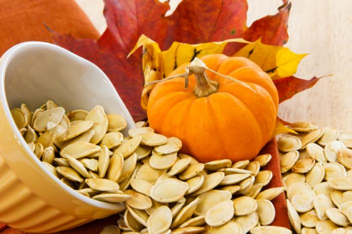pumpkin-seeds-with-pumpkin-and-leaves