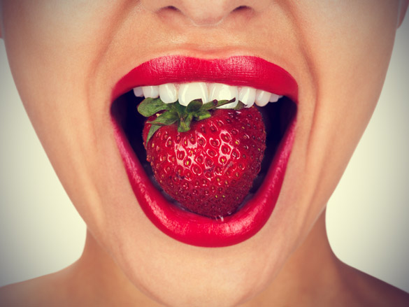 woman-with-perfect-white-teeths-eating-strawberry