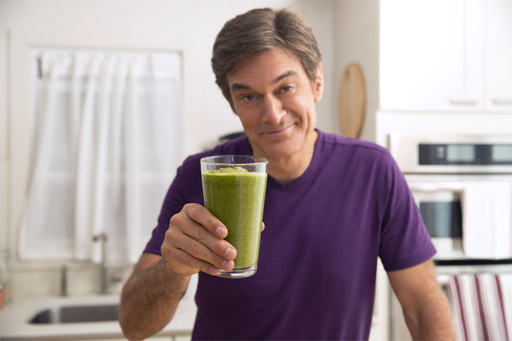 OZ – holding up green smoothie