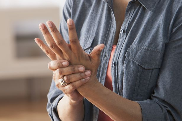 Older-Black-woman-rubbing-her-hands--Arthritis