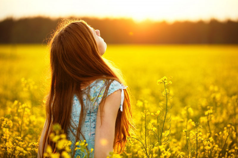 woman-with-face-in-sun