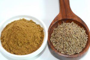 Closeup view of cumin and cumin powder