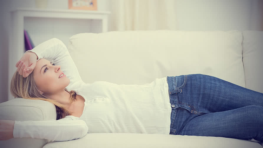 woman-lying-on-sofa-and-thinking